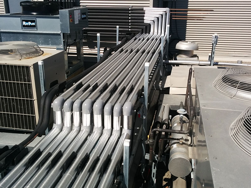 Roof insulated pipe installation